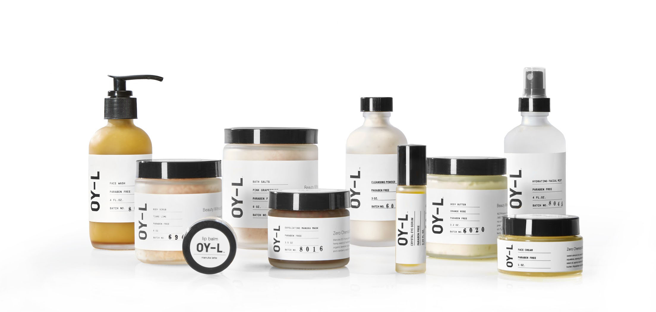 OY-L Skincare product line. Several white bottles and containers with black lids and the letters OY-L centered on the front.